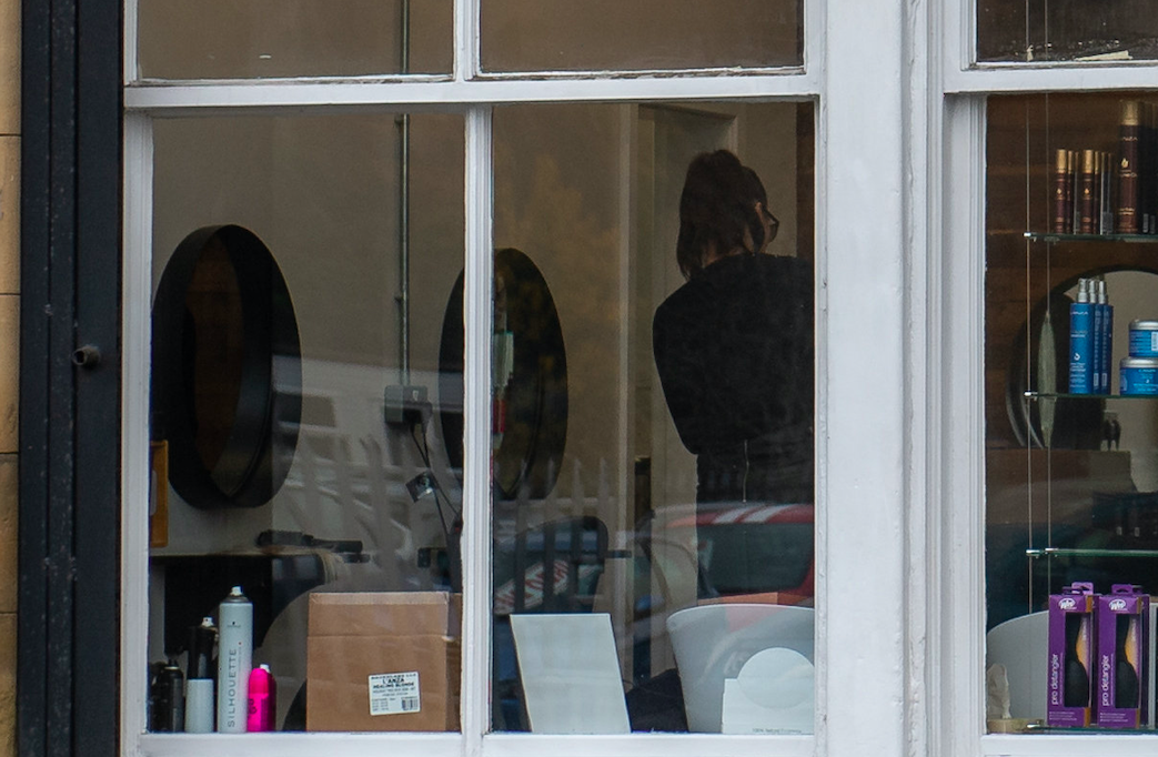 Pictures showed customers being served at Quinn Blakey Hairdressing during lockdown. (SWNS)