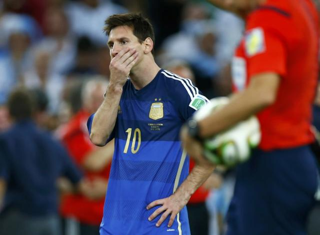 Argentina's Lionel Messi reacts after losing their 2014 World Cup final against Germany at the Maracana stadium in Rio de Janeiro July 13, 2014. REUTERS/Eddie Keogh (BRAZIL - Tags: SOCCER SPORT WORLD CUP)