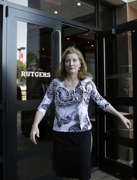 Rutgers incoming athletic director Julie Hermann walks from Rutgers University's Hale Center in Piscataway, N.J., Wednesday, June 5, 2013. Hermann says the problems she encountered as a women's volleyball coach at Tennessee are part of the reason she's a good fit as a sports administrator. (AP Photo/Mel Evans)