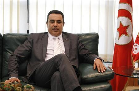 Tunisia's Industry Minister Mehdi is pictured in his office in Tunis