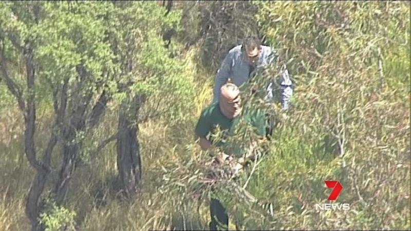 The accused helping with the search today. Photo: 7 News