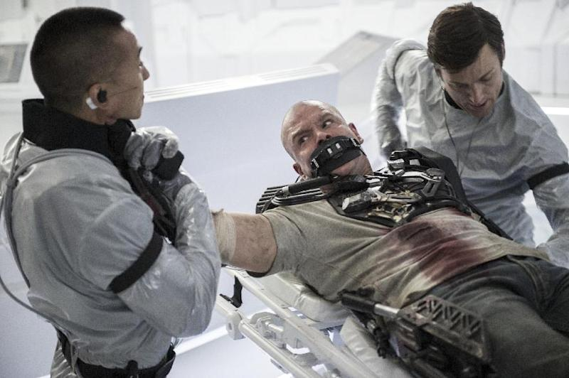 "This film publicity image released by TriStar, Columbia Pictures-Sony shows Matt Damon, center, in a scene from ""Elysium."" (AP Photo/TriStar, Columbia Pictures - Sony, Kimberley French)"