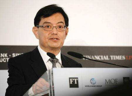 FILE PHOTO: Singapore's Finance Minister Heng Swee Keat gives a keynote speech at the World Bank - Singapore Infrastructure Finance Summit in Singapore April 5, 2018. REUTERS/Edgar Su/File Photo