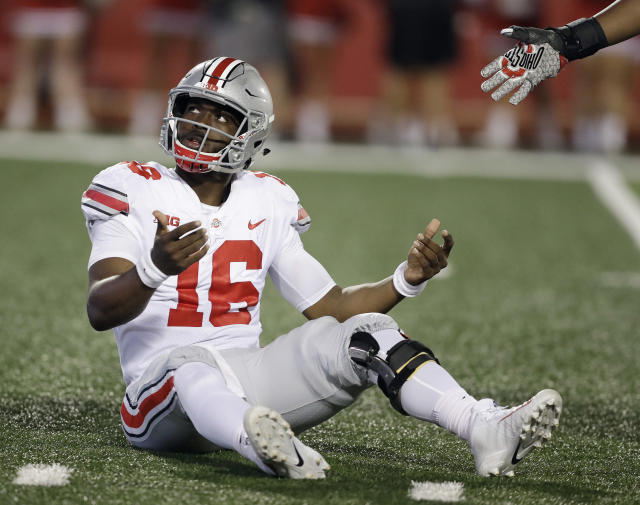 Ohio State quarterback J.T. Barrett looks up at an Indiana player after being hit on a pass. (AP)