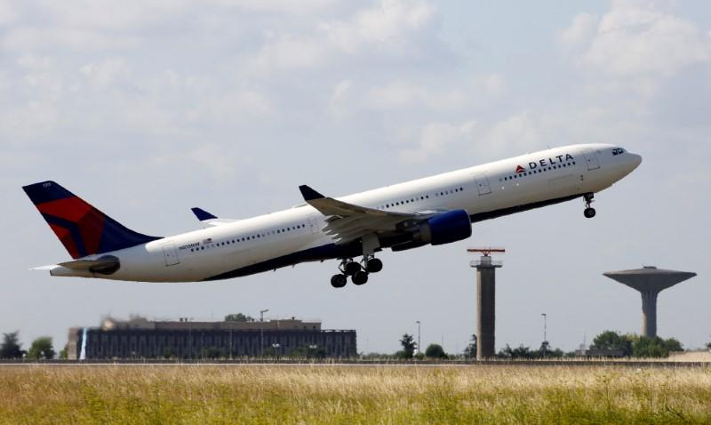 A Delta Air Lines Airbus A330 aircraft takes off at the Charles de Gaulle airport in Roissy