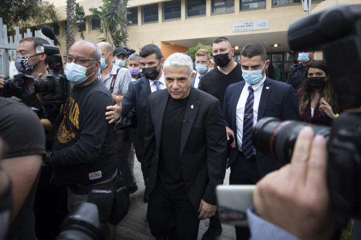 Yesh Atid party leader Yair Lapid leaves after he voted for Israel's parliamentary election at a polling station in Tel Aviv, Israel, Tuesday, March. 23, 2021. Israel is holding its fourth election in less than two years. (AP Photo/Sebastian Scheiner)