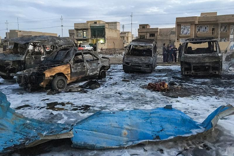 A picture taken with a mobile phone on February 16, 2017 shows burnt vehicles at the scene of a massive car bomb which killed dozens in a used car market in southern Baghdad (AFP Photo/Ahmad MOUSA)