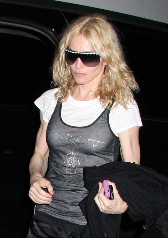 """Madonna attended Kabbalah services in New York Friday night without her wedding ring. The Material Girl, whose eight-year marriage to Guy Ritchie is on the rocks, reportedly sought legal advice from Paul McCartney's divorce lawyer last week. Jose Perez/<a href=""""http://www.infdaily.com"""" target=""""new"""">INFDaily.com</a> - June 27, 2008"""