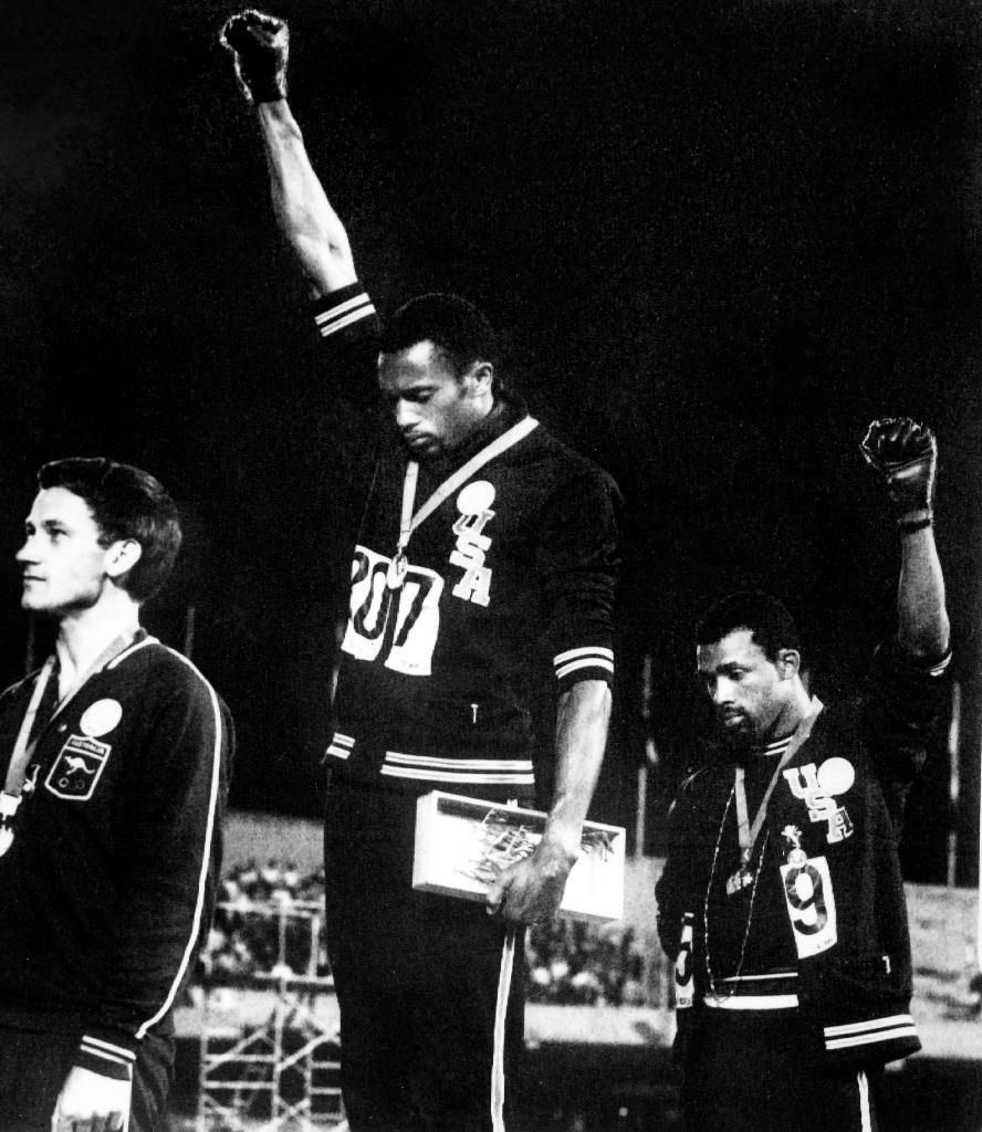The raised fists of Tommie Smith (C) and John Carlos sent shockwaves around the world (AFP Photo/STR)