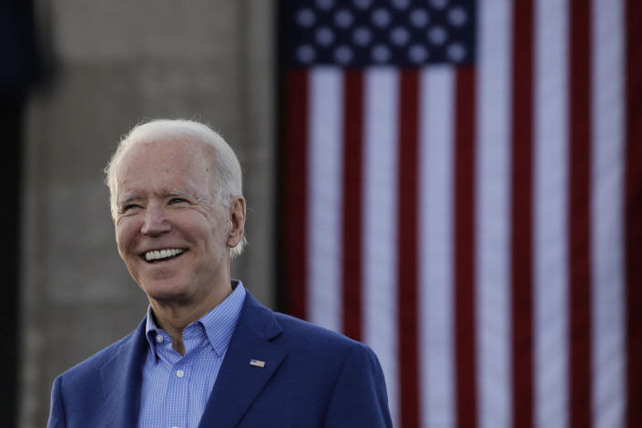 """FILE - In this March 7, 2020, file photo Democratic presidential candidate former Vice President Joe Biden acknowledges the crowd during a campaign rally in Kansas City, Mo. In an effort to ease concerns about his age, the 77-year-old presumptive Democratic nominee has said he wouldn't seek reelection if his mental or physical health declined. He has also referred to himself as a """"transition candidate,"""" acting as a bridge to a younger generation of leadership. (AP Photo/Charlie Riedel, File)"""
