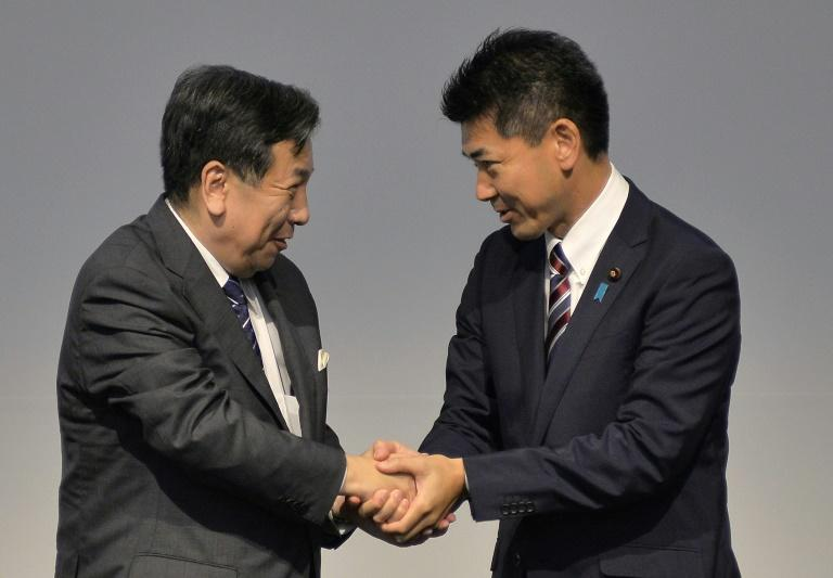 Japan opposition unites as snap election rumours swirl