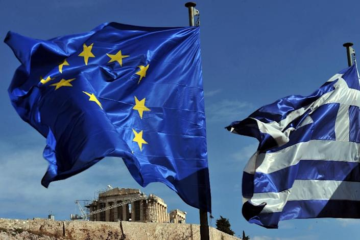 Greek and European union flags flutters in front of the Acropolis in Athens on November 5, 2013 (AFP Photo/Louisa Gouliamaki)