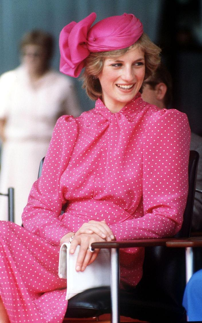 """<p>Princess Diana look radiant in pink and polka-dots (<a href=""""https://www.townandcountrymag.com/style/fashion-trends/g28367509/princess-diana-polka-dots-style/"""" rel=""""nofollow noopener"""" target=""""_blank"""" data-ylk=""""slk:one of her signature patterns"""" class=""""link rapid-noclick-resp"""">one of her signature patterns</a>) in Perth, Australia.</p>"""