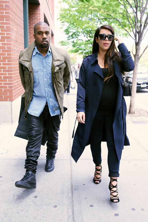 Kim Kardashian stuck to black and teamed her casual look with heels and a navy coat. Copyright [Splash]