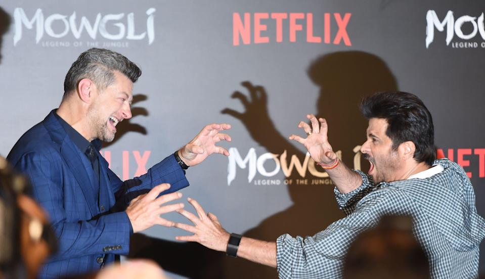 British actor-director Andy Serkis (L) play acts with Indian Bollywood actor Anil Kapoor during a press conference for Netflix's 'Mowgli: Legend of the Jungle' in Mumbai on November 25, 2018, ahead of its world premiere. - The upcoming film, based on stories collected in the book 'All the Mowgli Stories' by Rudyard Kipling, is due to be released on Netflix on December 7. (Photo by Indranil MUKHERJEE / AFP) (Photo credit should read INDRANIL MUKHERJEE/AFP/Getty Images)
