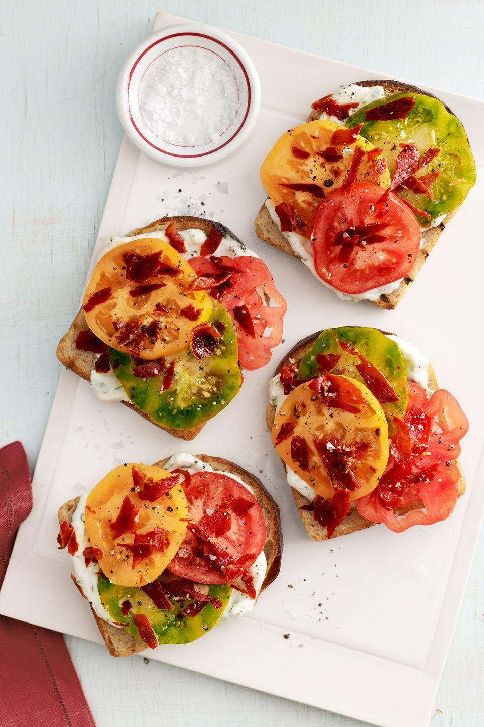 """<p>Though this sandwich is fresh and light, prosciutto keeps it satisfying and substantial enough to make it a filling summer lunch.</p><p><strong><a href=""""https://www.countryliving.com/food-drinks/recipes/a4218/heirloom-tomato-sandwiches-recipe-clv0913/"""" rel=""""nofollow noopener"""" target=""""_blank"""" data-ylk=""""slk:Get the recipe"""" class=""""link rapid-noclick-resp"""">Get the recipe</a>.</strong></p>"""