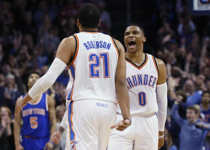 Oklahoma City Thunder guard Russell Westbrook (0) celebrates with forward Andre Roberson (21) after a basket by Roberson during the second quarter of the team's NBA basketball game against the New York Knicks in Oklahoma City, Wednesday, Feb. 15, 2017. (AP Photo/Sue Ogrocki)