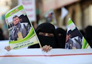 Yemeni women hold a portrait of Shiite Huthi rebel leader Abdulmalik al-Huthi at a rally in Sanaa, on March 31, 2015 to protest against the Saudi-led Arab air strikes on Huthi militia targets (AFP Photo/Mohammed Huwais)