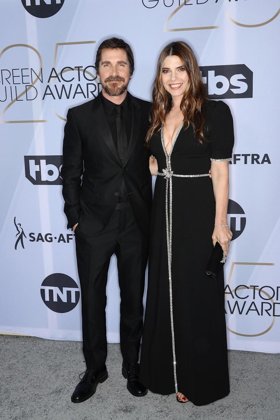 <p>Christian Bale and Sibi Blazic both wore black to the 2019 Screen Actors Guild Awards. (Photo: Getty Images) </p>