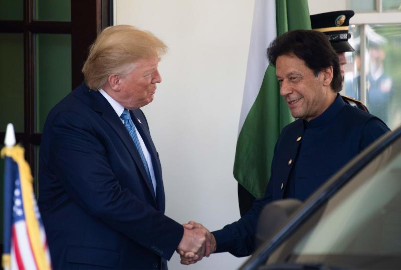 US President Donald Trump (L) greets Pakistani Prime Minister Imran Khan at the White House in Washington, DC, on July 22, 2019. (Photo by Jim WATSON / AFP) (Photo credit should read JIM WATSON/AFP/Getty Images)