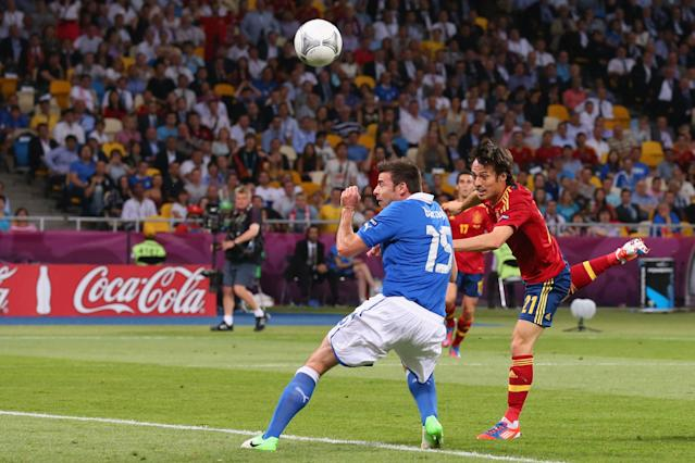 KIEV, UKRAINE - JULY 01: David Silva (R) of Spain scores the opening goal during the UEFA EURO 2012 final match between Spain and Italy at the Olympic Stadium on July 1, 2012 in Kiev, Ukraine. (Photo by Alex Livesey/Getty Images)