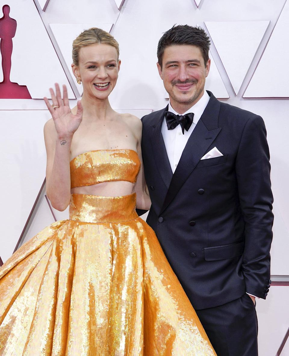 LOS ANGELES, CALIFORNIA – APRIL 25: (L-R) Carey Mulligan and Marcus Mumford attend the 93rd Annual Academy Awards at Union Station on April 25, 2021 in Los Angeles, California. (Photo by Chris Pizzello-Pool/Getty Images)