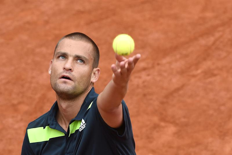 Russia's Mikhail Youzhny serves during his first-round match at the French Open in Paris, on May 25, 2014