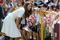 <p>A playful Duchess of Cambridge sticks her tongue out at young fans greeting her at Gardens by the Bay during her visit to Singapore.</p>