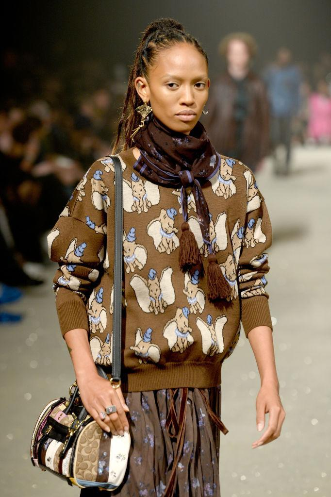 A model walks the runway for Coach