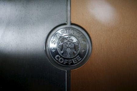 A Starbucks logo is seen on an espresso machine in a store inside the Tom Bradley terminal at LAX airport in Los Angeles