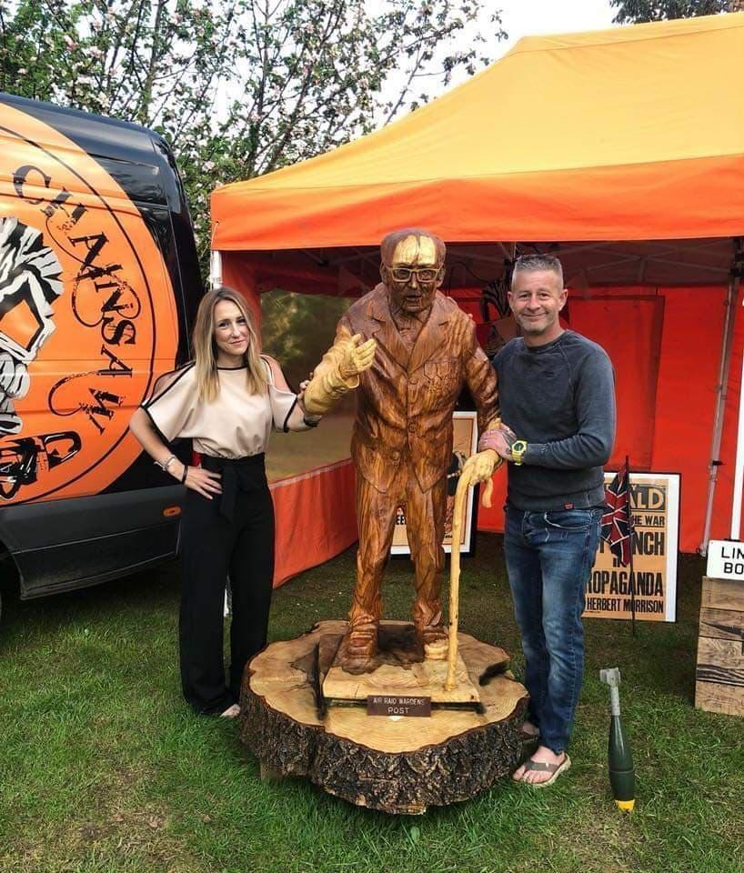 Adele Dunham and Simon Bogg with the wood carving of Sir Tom last year (Hannah-Jayne King)