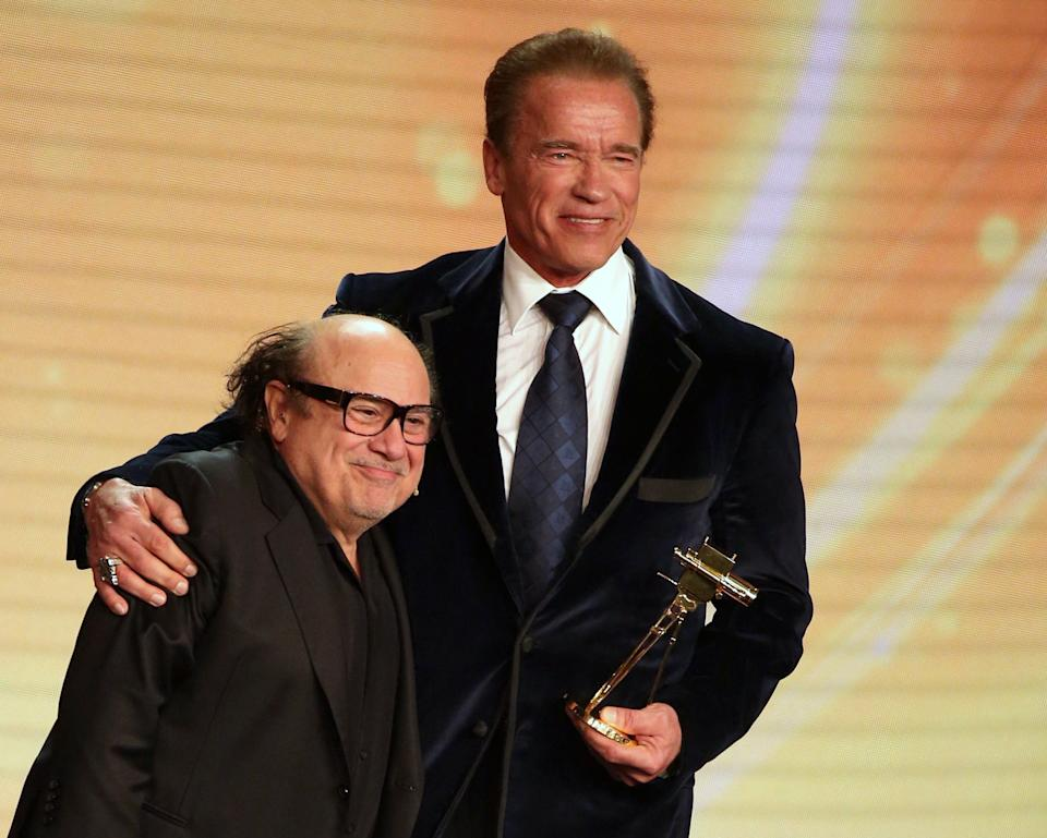 US actor and former governor of California Arnold Schwarzenegger (R) poses after receiving from US actor Danny DeVito his lifetime achievement award at the annual German film and television award ceremony Golden Camera ( Goldene Kamera ) in Hamburg, northern Germany, on February 27, 2015. AFP PHOTO / POOL / CHRISTIAN CHARISIUS        (Photo credit should read CHRISTIAN CHARISIUS/AFP via Getty Images)