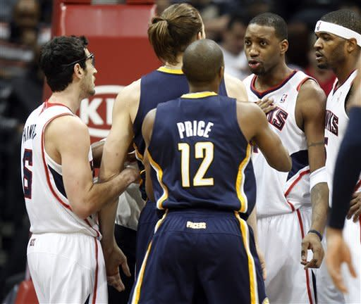 Atlanta Hawks' Tracy McGrady (1), right, and Indiana Pacers center Louis Amundson (17) are restrained by Hawks' Kirk Hinrich, left, and Pacers' A.J. Price (12) during the second half of an NBA basketball game Wednesday, Feb. 8, 2012 in Atlanta. Atlanta won 97-87. (AP Photo/John Bazemore)