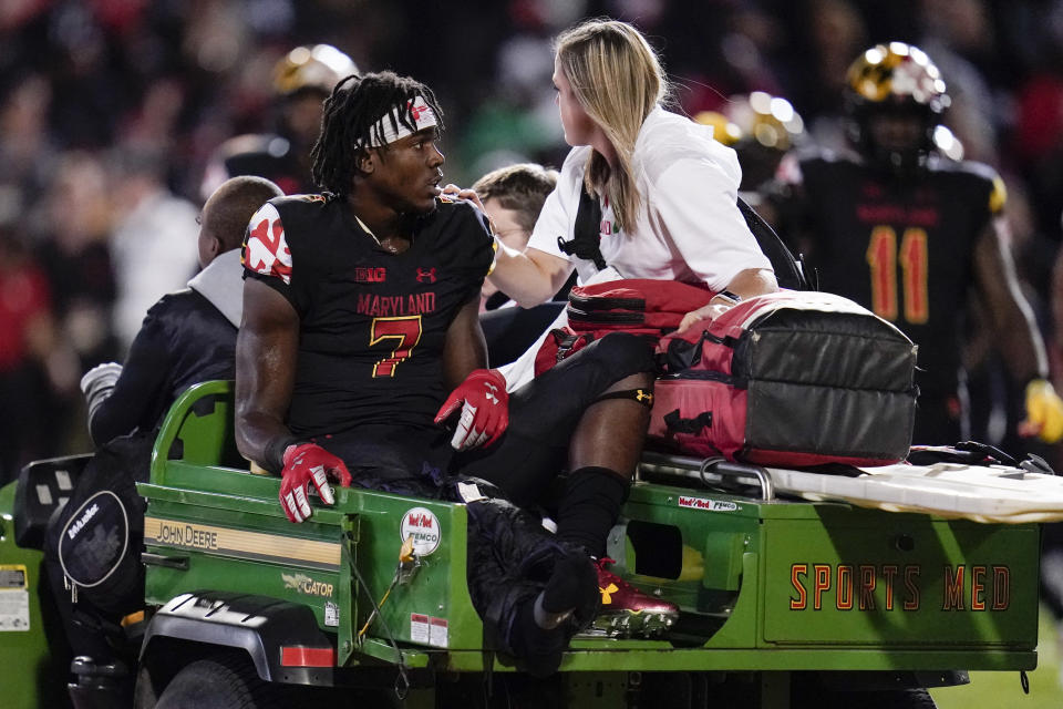 Maryland wide receiver Dontay Demus Jr. is carted off the field during the first half of an NCAA college football game against Iowa, Friday, Oct. 1, 2021, in College Park, Md. (AP Photo/Julio Cortez)