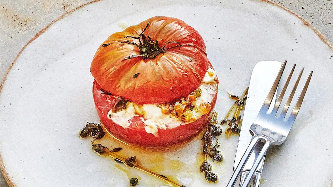 """You don't have to use mozzarella; other fresh cheeses like ricotta, goat, or feta will work, though you might miss that stretchy molten-cheese effect. <a href=""""https://www.bonappetit.com/recipe/cheesy-stuffed-tomatoes?mbid=synd_yahoo_rss"""">See recipe.</a>"""