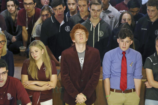 <p>Jaclyn Corin, Ryan Deitsch and Alfonso Calderon along with their classmates from Marjory Stoneman Douglas High School listen as fellow student Lorenzo Prado speaks at a news conference recalling the day of the shooting, in Tallahassee, Fla., Wednesday, Feb. 21, 2018. (Photo: Susan Stocker/South Florida Sun-Sentinel via AP) </p>