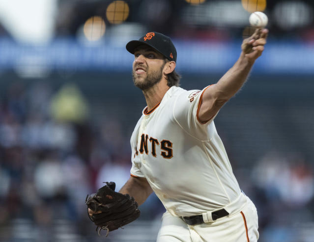 FILE - In this Sept. 9,2019, file photo, San Francisco Giants starting pitcher Madison Bumgarner throws against a Pittsburgh Pirates' batter in the second inning of a baseball game in San Francisco. Bumgarner has received a $17.8 million qualifying offer from the Giants, a move that likely will decrease demand for him in the free-agent market. (AP Photo/John Hefti, File)
