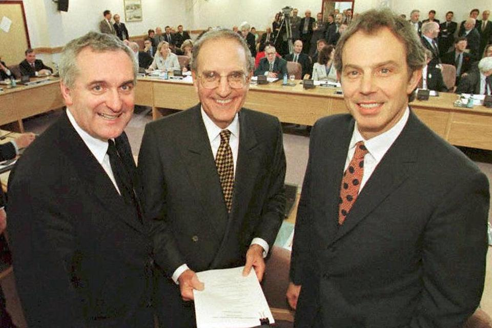 Tony Blair, US Senator George Mitchell (centre) and Irish PM Bertie Ahern smiling after they signed a historic agreement for peace in Northern Ireland in 1998, ending a 30-year warAFP/Getty