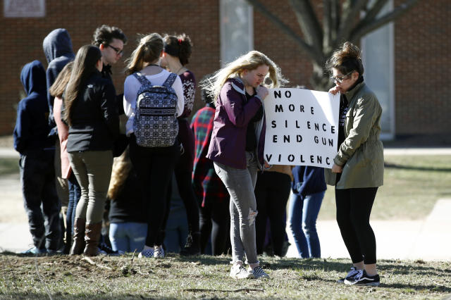 <p>Students hold a sign during a student walkout outside Perry Hall High School in Perry Hall, Md., Wednesday, March 14, 2018. Students across the country planned to participate in walkouts Wednesday to protest gun violence, one month after the deadly shooting inside a high school in Parkland, Florida. (Photo: Patrick Semansky/AP) </p>