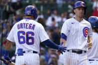 Chicago Cubs' Matt Duffy, right, celebrates with Rafael Ortega after scoring on a sacrifice fly by David Bote during the fourth inning of a baseball game against the St. Louis Cardinals in Chicago, Sunday, Sept. 26, 2021. (AP Photo/Nam Y. Huh)