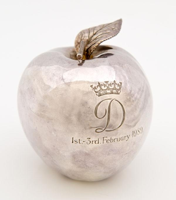 A rare silver apple given by Princess Diana to her dresser, Fay Appleby, to commemorate their visit to New York.  It's beleived to be one of only four made and is engraved with the Princess's crowned D monogram.  The apple was won by a collector in Colchester against international interest (Reeman Dansie)