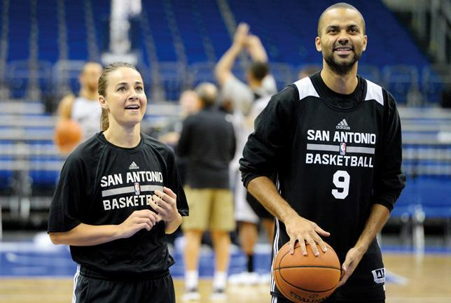 Becky Hammon (l), pictured with Tony Parker, was appointed to the San Antonio Spurs' coaching staff in the summer.