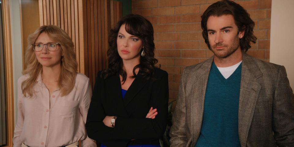 "Kate (Sarah Chalke), Tully (Katherine Heigl) and Ryan (Ben Lawson) don 1970s and 1980s style in flashbacks on ""Firefly Lane."""
