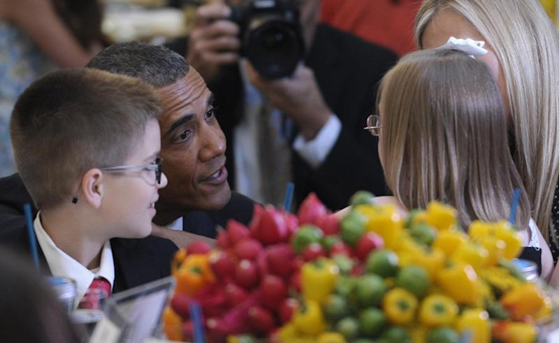 "President Barack Obama talks with Makenna Hurd of Mascot, Tenn., right, and Noah Koch, of Waterville, Maine, right, at the second annual White House Kids' ""State Dinner"" Tuesday, July 9, 2013, in the East Room of the White House in Washington. First lady Michelle Obama welcomed 54 children to the White House for creating winning recipes as part of a healthy lunch contest. (AP Photo/Susan Walsh)"