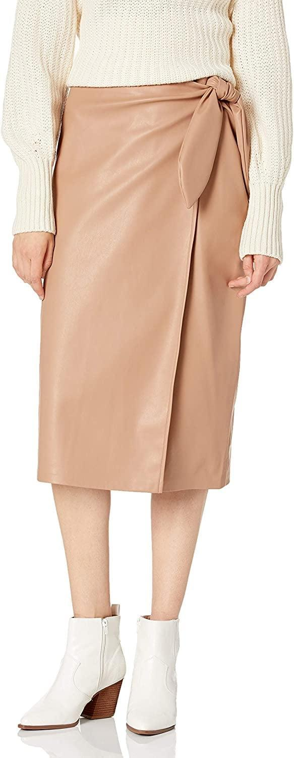 <p>Our editors are obsessed with this <span>The Drop Manon Faux-Leather Wrap-Front Midi Skirt</span> ($55).</p>