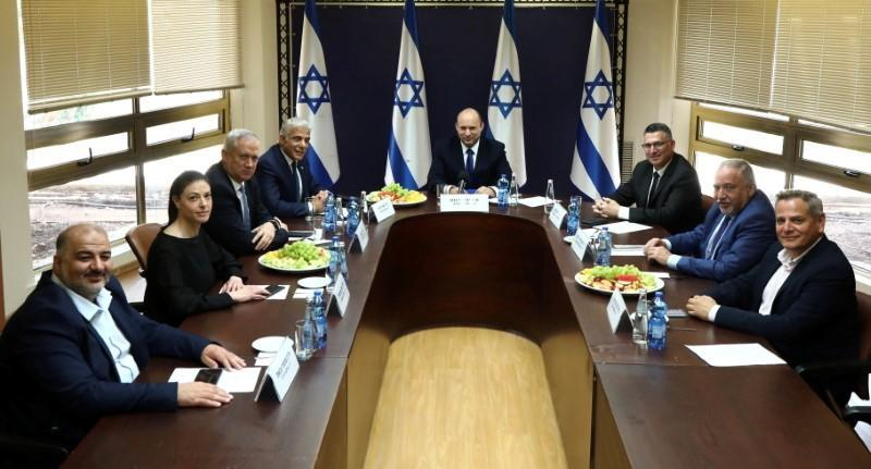 FILE PHOTO: Party leaders of the proposed new coalition government, pose for a picture at the Knesset, Israel's parliament, before the start of a special session to approve and swear-in the coalition government, in Jerusalem