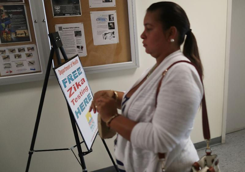 A pregnant woman signs up for free Zika testing in Miami Beach