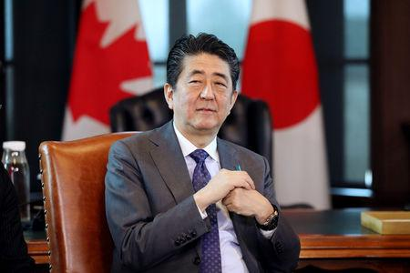 FILE PHOTO: Japan's PM Abe takes part in a meeting with Canada's PM Trudeau on Parliament Hill in Ottawa