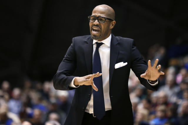 FILE - In this Jan. 10, 2015, file photo, Penn coach Jerome Allen shouts instructions to his players during the second half of an NCAA college basketball game against Princeton in Princeton, N.J. Allen was hit a 15-year show-cause penalty after he accepted $300,000 in bribes to get a wealthy Florida businessman's son into the University of Pennsylvania. The Quakers also were slapped by the NCAA with two years of probation, were fined $5,000 and suffered recruiting punishments. Allen went 66-104 with the Quakers. He was hired by the Boston Celtics in 2015 and remains on the coaching staff. (AP Photo/Mel Evans, File)