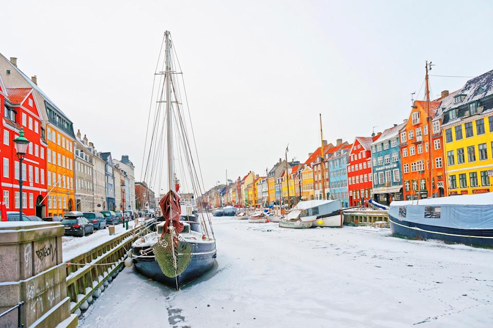 """When you visit the birthplace of <a href=""""https://www.cntraveler.com/gallery/hygge-lagom-coorie-which-lifestyle-philosophy-is-best-for-you?mbid=synd_yahoo_rss"""" rel=""""nofollow noopener"""" target=""""_blank"""" data-ylk=""""slk:hygge"""" class=""""link rapid-noclick-resp"""">hygge</a> (basically the Danish concept of """"coziness""""), you better believe your winter vacation is going to be inviting. That feeling can be found throughout <a href=""""https://www.cntraveler.com/destinations/copenhagen?mbid=synd_yahoo_rss"""" rel=""""nofollow noopener"""" target=""""_blank"""" data-ylk=""""slk:Copenhagen"""" class=""""link rapid-noclick-resp"""">Copenhagen</a>, from pastry shops to <a href=""""https://www.cntraveler.com/gallery/best-hotels-in-copenhagen?mbid=synd_yahoo_rss"""" rel=""""nofollow noopener"""" target=""""_blank"""" data-ylk=""""slk:inviting hotels"""" class=""""link rapid-noclick-resp"""">inviting hotels</a>. Don't feel like you have to stay indoors to enjoy the season, though. Those Michelin-starred restaurants, <a href=""""https://www.cntraveler.com/activities/copenhagen/tivoli-gardens?mbid=synd_yahoo_rss"""" rel=""""nofollow noopener"""" target=""""_blank"""" data-ylk=""""slk:Tivoli Gardens"""" class=""""link rapid-noclick-resp"""">Tivoli Gardens</a>, and canal views are certainly worth bundling up for. And is it just us—or do the buildings of Nyhavn look even more brightly colored against a snowy background?"""